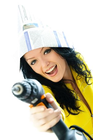 beautiful young excited woman holding a drill in her hand isolated against white background