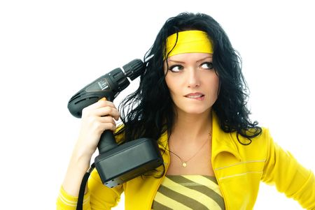 beautiful angry woman with a drill isolated against white background photo
