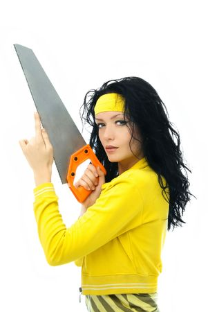 sexy young brunette woman holding a saw in her hands isolated against white background Stock Photo