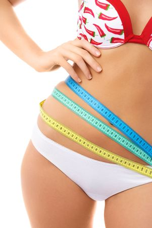 slim young caucasian woman with three colorful measuring tapes around her belly  Stock Photo - 4129616