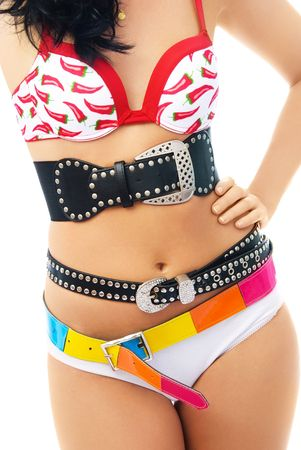 belly pepper: young slim woman wearing underwear and three belts isolated against white background