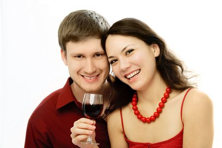 good mood: happy young couple drinking vine and embracing
