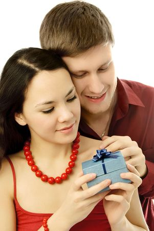 bring: happy young couple, a man gives a present to his wife
