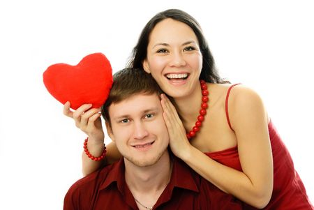 cheerful young woman and her husband embrace and laugh photo