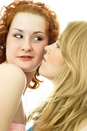 two young girls talking to each other, one girl suspects the other of something Stock Photo - 4175643