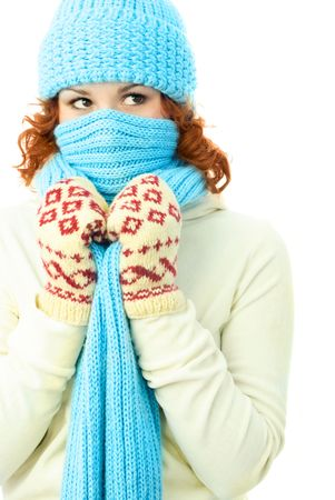young ginger woman wearing warm winter clothes and hiding from the frost photo