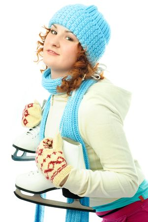iceskating: beautiful ginger girl wearing warm winter clothes goes ice-skating Stock Photo