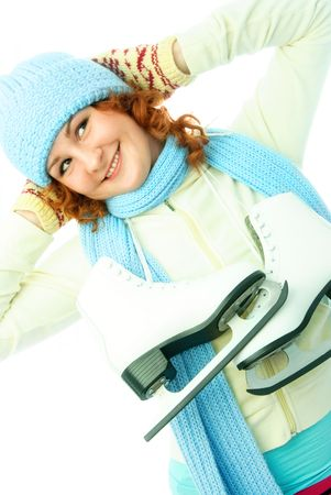 cheerful beautiful ginger girl dressed in warm winter clothes goes ice-skating Stock Photo - 4185984
