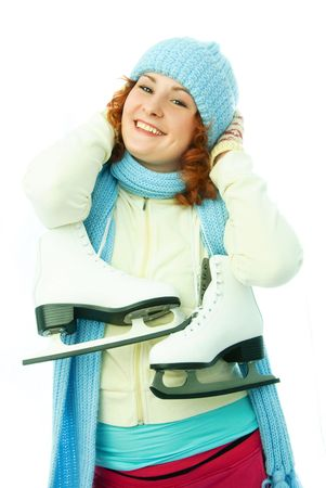 sportswoman: beautiful cheerful young woman dressed in warm winter clothes goes ice-skating