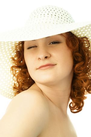 coquettish: beautiful coquettish woman wearing a summer hat winks to us