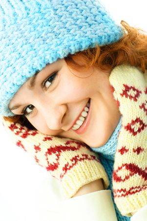 happy beautiful young woman wearing a winter hat, scarf and mittens photo