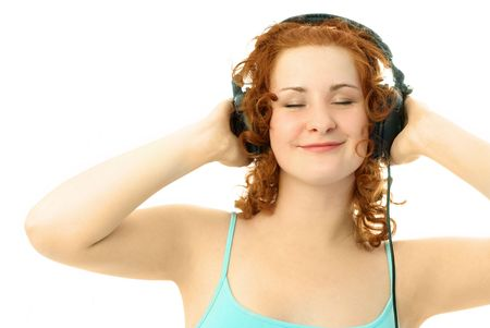 happy young attractive woman with beautiful curly ginger hair  listening to the music photo