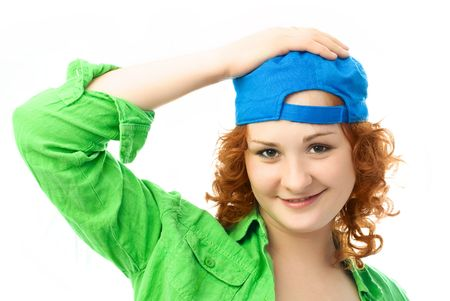 happy beautiful girl with curly ginger hair wearing colorful clothes photo