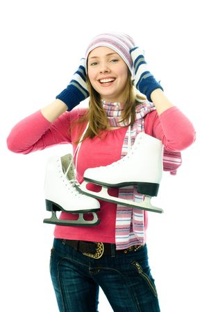 ice skate: beautiful happy young woman goes ice-skating, isolated against white background Stock Photo