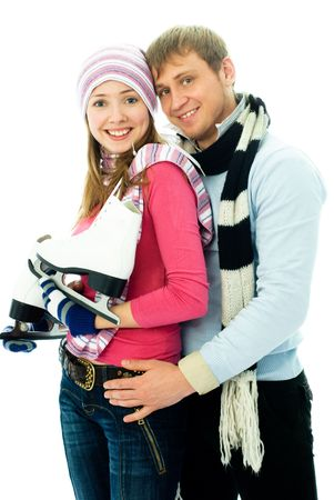 happy young couple going ice-skating, isolated against white background photo