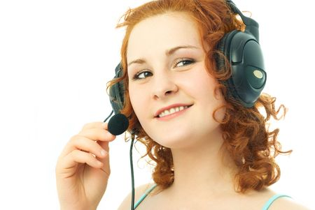 happy beautiful girl wearing earphones with a microphone, talking to her friend and smiling photo