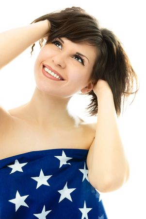 happy beautiful young woman wrapped into an American flag photo
