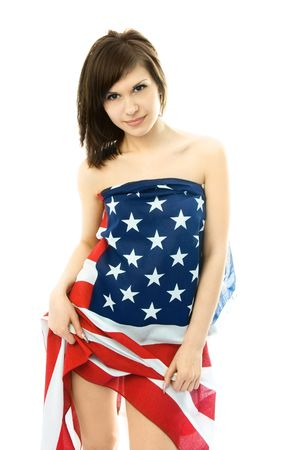 sexy beautiful young nude woman wrapped into an American flag photo