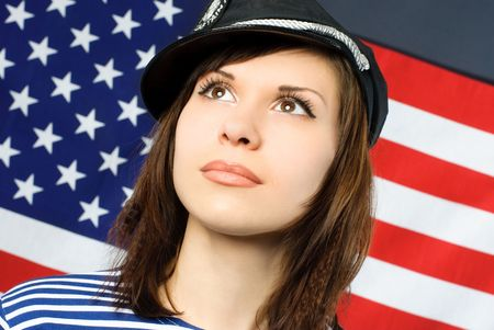 beautiful young thoughtful sailor standing opposite an American flag Stock Photo - 4208028