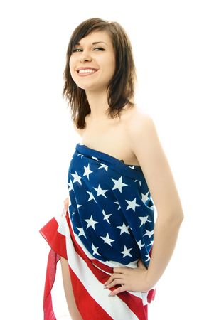 beautiful sexy young woman wrapped into the American flag, isolated against white background photo