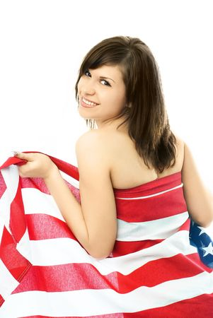 portrait of a happy beautiful young nude woman wrapped into the American flag photo