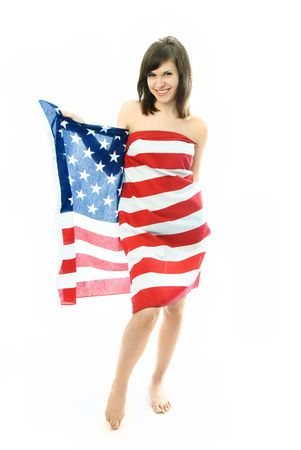 cheerful beautiful nude woman wrapped into the American flag photo