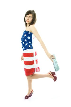 beautiful young woman wearing an American flag walks with a bag in her hand photo