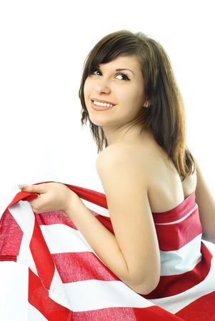 beautiful young nude woman wrapped into the American flag photo