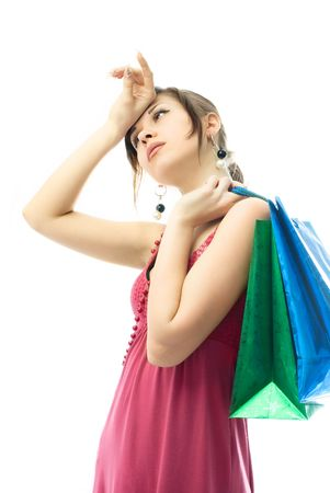 portrait of a beautiful elegant young woman tired of shopping photo