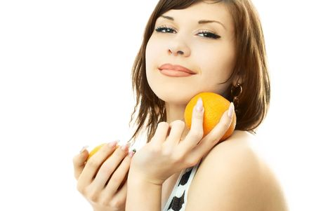 beautiful happy young brunette woman with oranges in her hands photo
