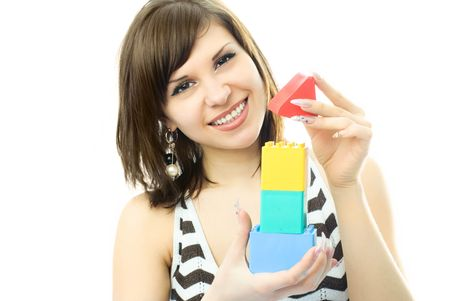 portrait of a young beautiful woman making a toy house Stock Photo - 4248108