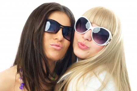 female sexuality: portrait of two young glamorous girls sending us an air kiss Stock Photo
