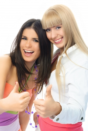 portrait of two happy excited girls with their thumbs up Stock Photo - 4259958