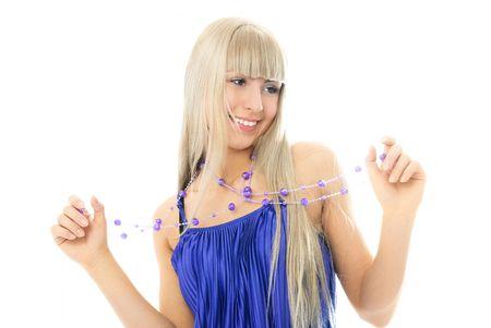 beautiful young blond woman wearing beads and a purple dress photo