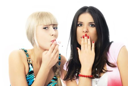 portrait of two girls, one of them is smoking a cigarette and the other shows her surprise and disgust photo
