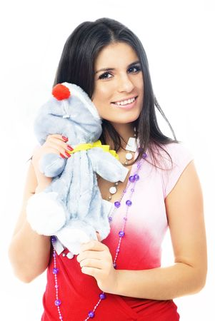 portrait of a beautiful brunette girl embracing a toy mouse photo