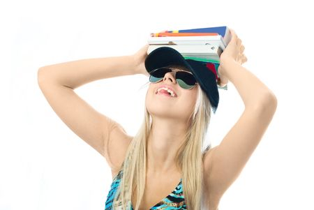 young blond woman with a lot of books on her head against white background photo
