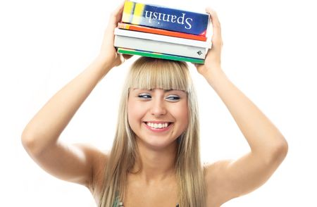 happy beautiful laughing blond girl with a lot of book on her head photo