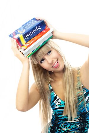 beautiful blond girl holding a lot of book on her head and unwilling to do homework photo