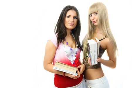 portrait of two beautiful young students with a lot of books photo