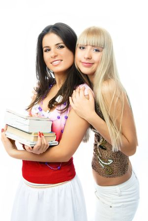 portrait of two young beautiful embracing students with a lot of books Stock Photo - 4259957