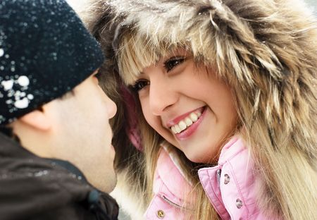 portrait of a happy young couple talking and smiling outdoor  photo