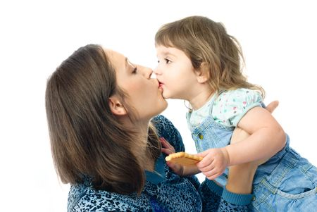 kiss biscuits: happy family, young mother and her one year old daughter kissing