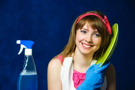 portrait of a beautiful cheerful young housewife washing the dishes photo