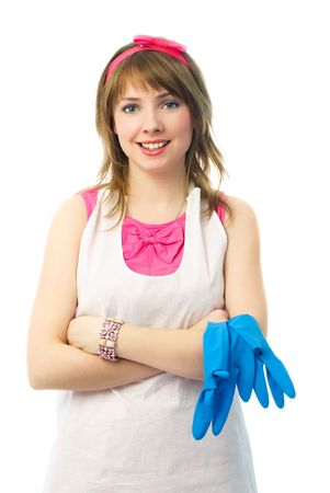 portrait of a beautiful satisfied young housewife with blue rubber gloves photo