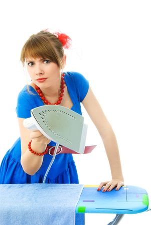 aggressive young housewife ironing the towel against white background photo