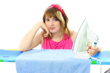 beautiful young woman dressed in pink retro clothes ironing towels  photo