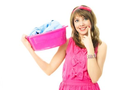 coquettish: beautiful young housewife dressed in pink clothes with a basin full of clothes