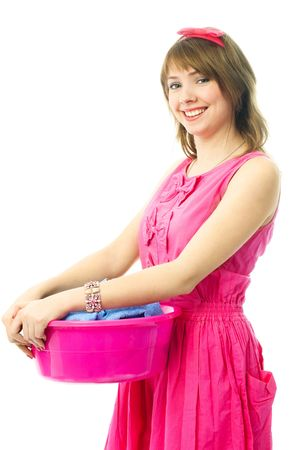 young housewife dressed in pink dress with a basin full of clothes photo