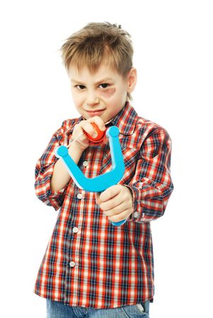 naughty boy with a bruise under his eye holding a slingshot and aiming at us Stock Photo - 4321672